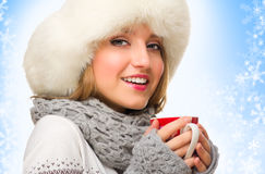 Young girl with mug on winter background Stock Photography