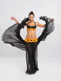Young girl mulatto dancing in a long black dress candid Stock Photography
