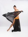Young girl mulatto dancing in a long black dress candid Royalty Free Stock Photography