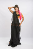Young girl mulatto dancing in a long black dress candid Stock Photos