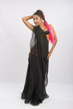 Young girl mulatto dancing in a long black dress candid Stock Image