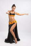Young girl mulatto dancing in a long black dress candid Royalty Free Stock Photos