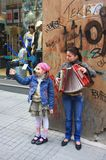 Street Musicians of Istanbul. Young Girl Musician Playing Accordion to make living in Beyoglu District of Istanbul royalty free stock photography