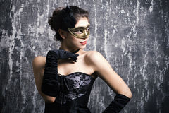 young girl in a mysterious mask Royalty Free Stock Photo