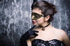 Young girl in a mysterious mask Stock Photo
