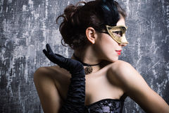 Young girl in a mysterious mask Royalty Free Stock Images
