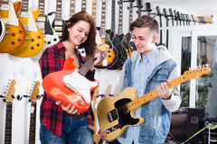 Young girl nad boy are deciding on suitable amp Stock Image
