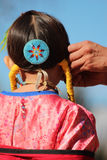 Young Girl - Native American Powwow. A young Indian girl prepares for her performance at the Heard Museum of Native Cultures and Art, located in Phoenix, Arizona Stock Images