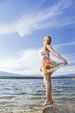 Young girl in the nature. Young blonde beautiful girl posing near a lake Royalty Free Stock Image