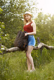 Young girl on nature with hat and backpack. Summer Stock Image