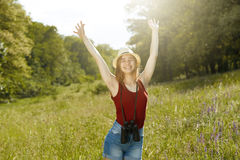 Young girl on nature with hat and binocular. Summer Stock Photography