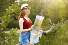 Young girl on nature with hat and map. Summer Royalty Free Stock Images
