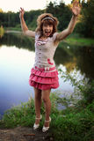 Young girl on the nature Royalty Free Stock Image