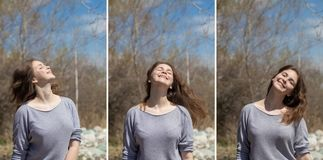 Young girl on nature with positive emotions. Relaxed, pleased with a smile on her face. Twists his head. Carefree fun pastime. Young girl on nature with positive royalty free stock photos
