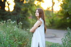 Young girl on nature shows emotions Royalty Free Stock Images