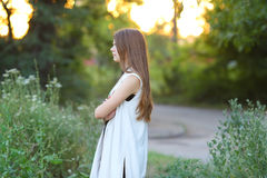 Young girl on nature shows emotions Royalty Free Stock Image