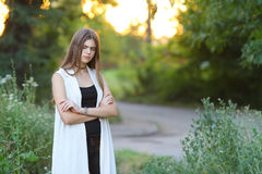 Young girl on nature shows emotions Royalty Free Stock Photo