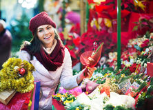 Young girl near counter with mistletoe Stock Images