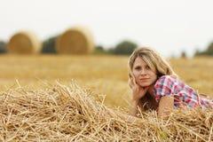 Young girl near haystacks Royalty Free Stock Photo