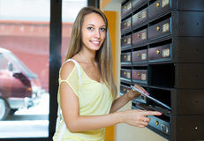 Young girl near posting box Royalty Free Stock Image