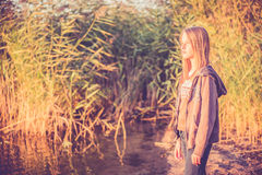 Young girl near reeds Royalty Free Stock Images