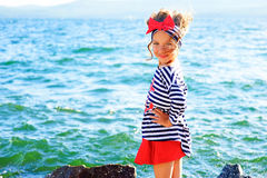 Young girl near the sea rock Stock Photography