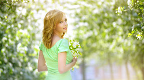 Young Girl Near The Apple Tree Stock Photos