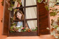 Young girl near the window Royalty Free Stock Images