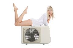Young girl with a new air conditioner Stock Photography