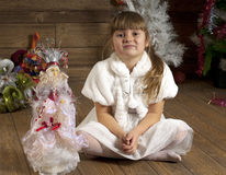 Young girl in New Year room Royalty Free Stock Image