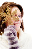 Young girl with a New Year's decorations. In the hands of Royalty Free Stock Photography