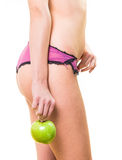 Young girl with nice body and apple in hand Stock Photo