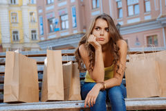 Young girl is not satisfied with their purchases Royalty Free Stock Photos