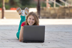 Young girl with a notebook smiling royalty free stock photography