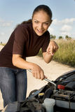 Young girl - novice at auto mechanic Royalty Free Stock Photography
