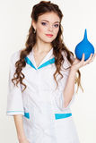 Young girl nurse with blue lavement in hands Stock Image