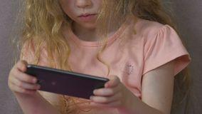 Young girl obsessed with smartphone, technoference and bad children behavior. Stock footage stock video