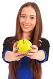 Young girl Offering Viewer an apple Royalty Free Stock Image
