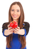 Young girl Offering Viewer an apple. Young girl offering a apple to someone, focus on apple. Isolated on white background Stock Photos