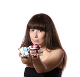 Young girl offers gifts Stock Images