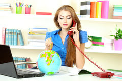 Young girl in the office Stock Photography