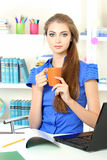 Young girl in the office Royalty Free Stock Image