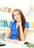Young girl in the office Stock Photo
