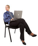Young girl in office clothes sitting on a chair, a Stock Image