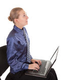 Young girl in office clothes sitting on a chair, a Royalty Free Stock Images
