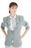 Young girl in office clouses. Young girl in a gray business suit on white background Royalty Free Stock Photos