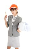 Young girl in office clouses. Young girl in a gray business suit on white background Stock Photography