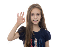 Young Girl with OK Gesture. Isolated on White Royalty Free Stock Photography