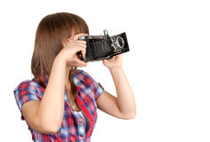 Young girl with old analog photo by camera Royalty Free Stock Image