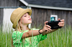 Young girl with old camera Stock Photos